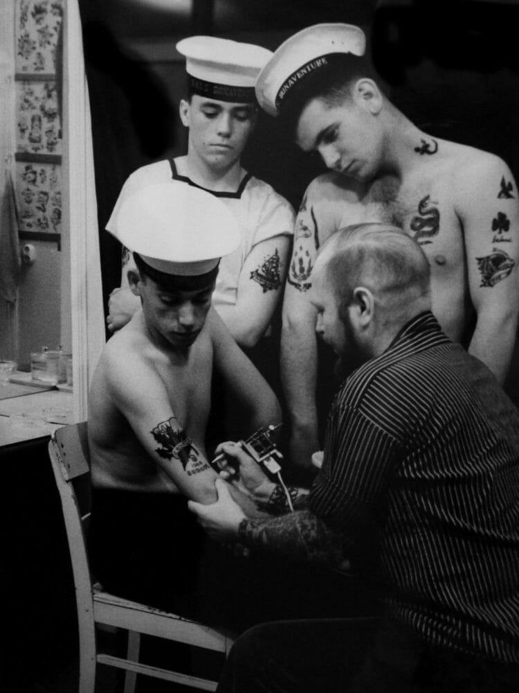 Sailors at a tattoo shop.