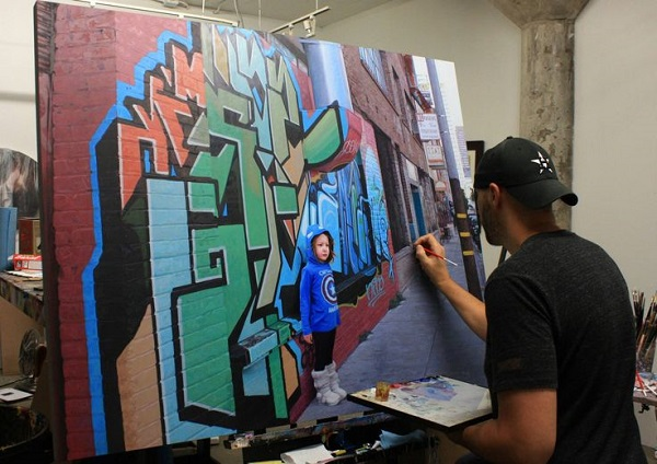 Kevin Peterson in his studio painting
