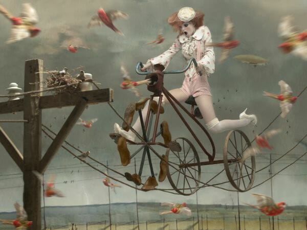 Eugenio Recuenco fashion girl on bike with birds photography