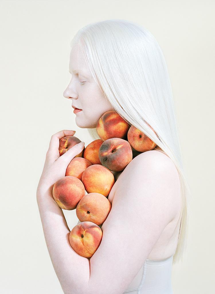 Petrina Hicks_woman holding peaches