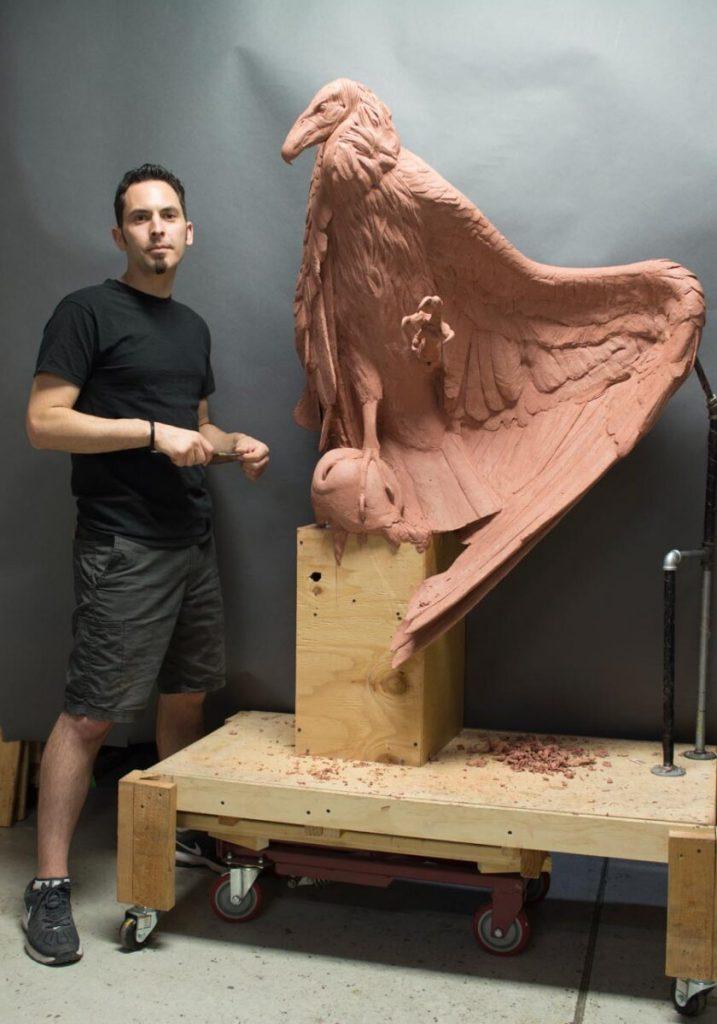 Adam Matano with WIP sculpture